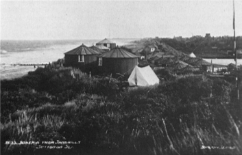 "Approximately 50 circular, corrugated iron huts resentfully referred to as ""Rusty pork pies"", were established at a holiday camp named Bohemia, near Sutton on Sea (Copyright: Lincolnshire County Council). These were let to holiday makers despite their poor drainage and ""acute threat to health"" (County Medical Officer of Health, 1931)."