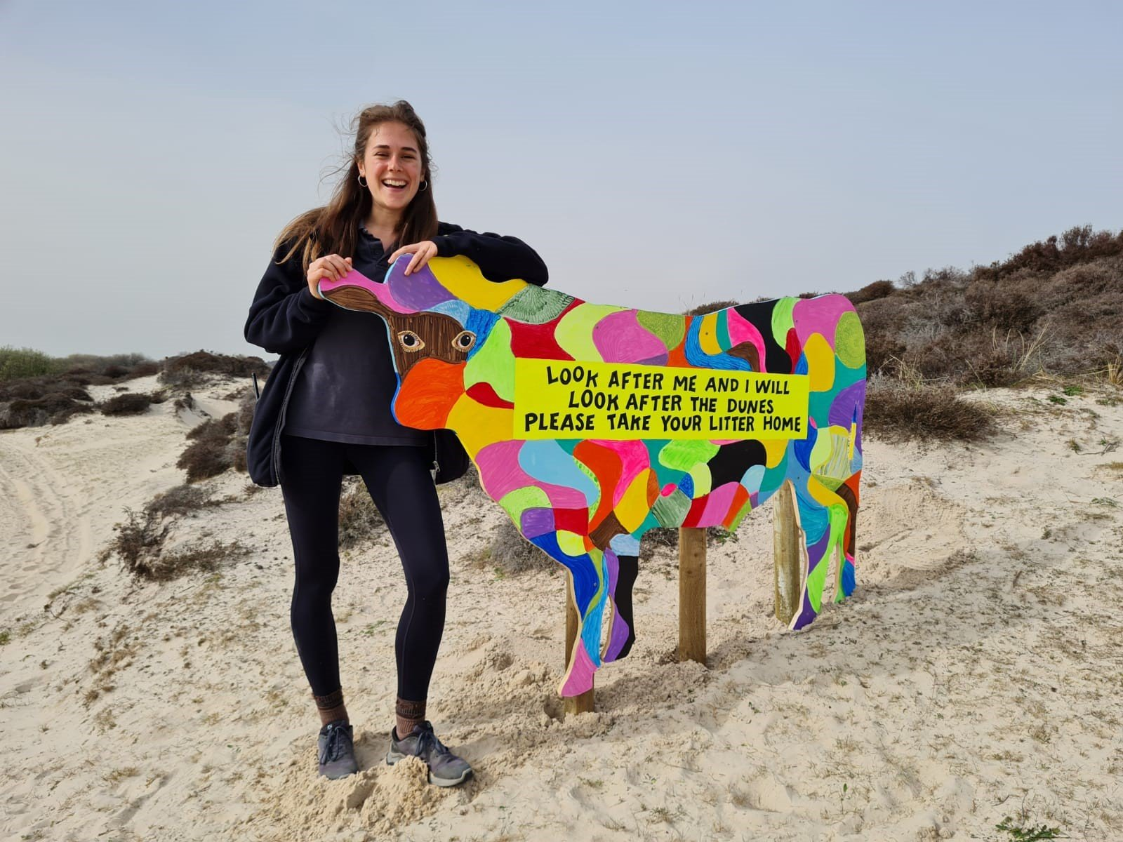 Julia with one of the arty cows that formed the community art trail through the dunes.